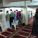 Muslims in Athens in an makeshift basement praying room