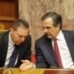 Greek FinMin Yiannis Stournaras (L) confers with PM Antonis Samaras