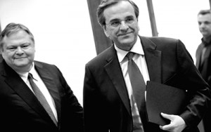 Greek PM Antonis Samaras (R) trailed by his Deputy PM Evangelos Venizelos