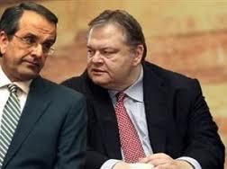 Greek PM Antonis Samaras (L) and his left-hand man, PASOK leader Evangelos Venizelos