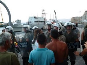 Riot police were needed to control an angry crowd at a Hydra taverna.