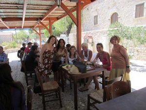 – Despina Siolas, M.D./Ph.D. (3rd from left) and Sunrise Tour participants at taverna  before Avgonyma, during the Chios fires of 2012.