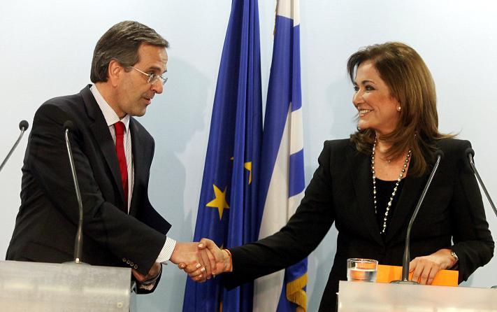 Greek Premier Antonis Samaras (L) when he was still talking to Dora Bakoyianni