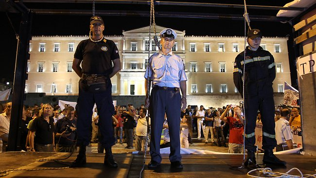 Greek military officers in a mock hanging to protest pay cuts