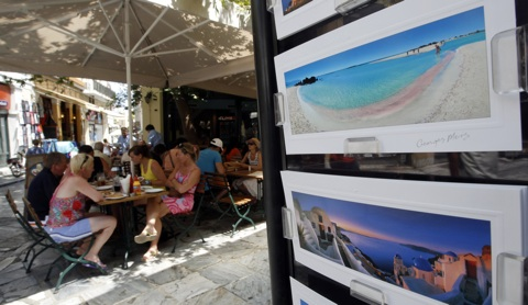 Tourists enjoy a meal at tourist district of Plaka in Athens