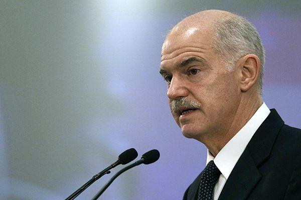 Greece's Prime Minister George Papandreou delivers a speech during an economic conference in Athens