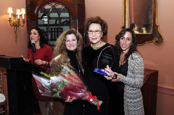 "Olga Alexakos (left) and Dr. Aphrodite Navab, present ""Greek American Woman of the Year' Award to Paulette Poulos"