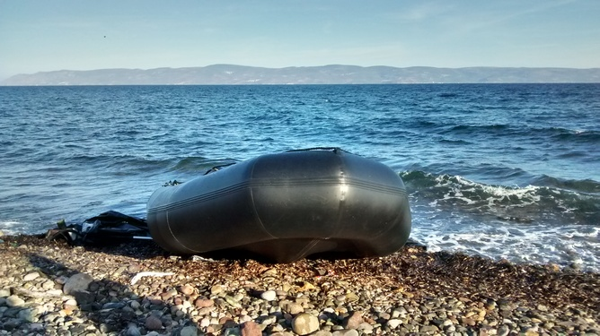 A dinghy on the Greek island of Lesvos with the shoreline of Turkey in the distance. Heaven Crawley, Author provided