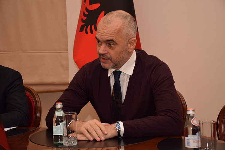 TIRANA, ALBANIA - DECEMBER 18: Albanian Prime Minister Edi Rama speaks during a meeting with Turkish Economy Minister Nihat Zeybekci (unseen) within Zeybekci's official visit in Tirana, Albania on December 18, 2014. (Photo by Olsi Shehu/Anadolu Agency/Getty Images)