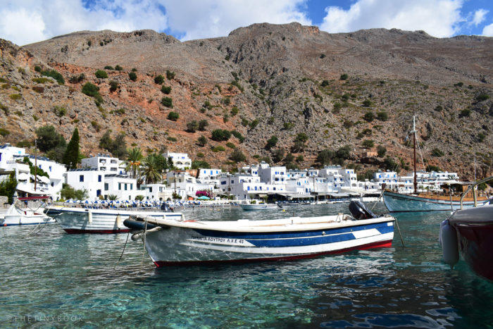 Small boats and ferries remain the easiest way to reach Loutro (Courtesy of The Tiny Book).
