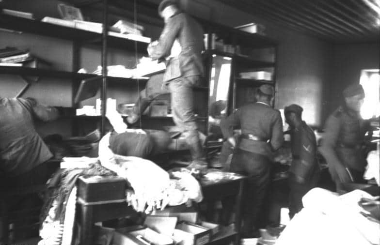German soldiers looting food from a store.