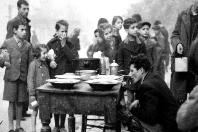 Children waiting to be served in a soup kitchen in Athens