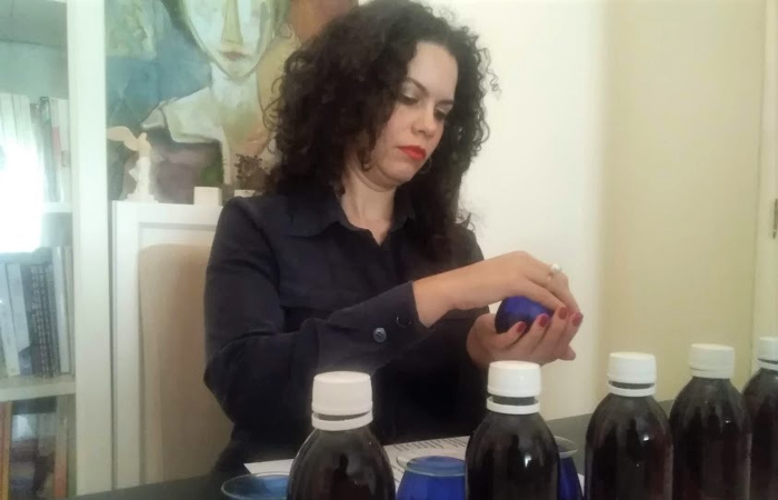 Irini Kokolaki preparing to taste olive oil