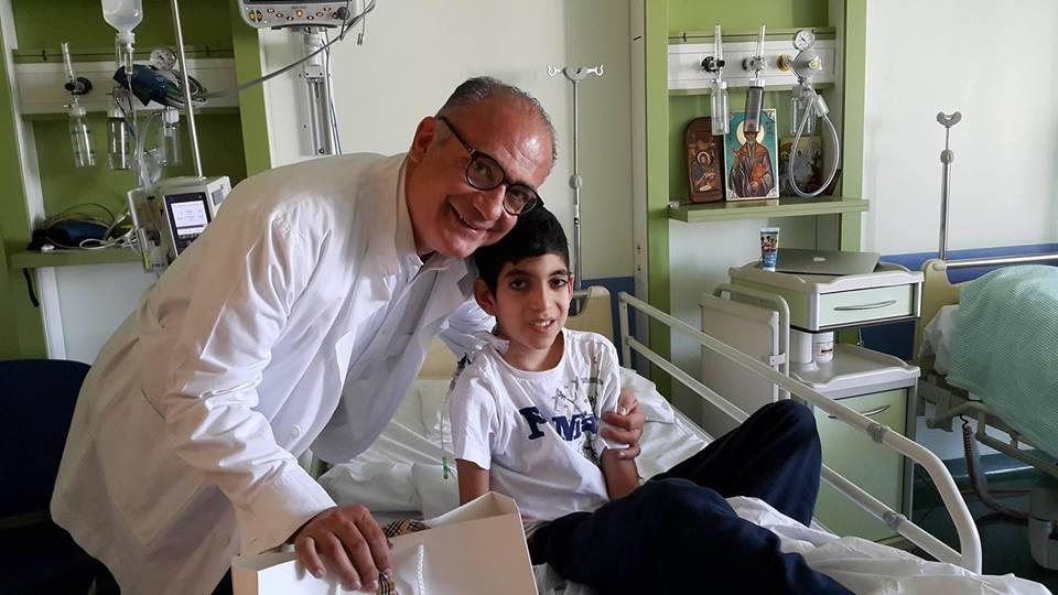 The Greek Heart Surgeon, Afksendiyos Kalangos with a patient