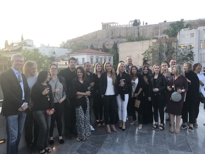 Members of the delegation pose underneath the Acropolis