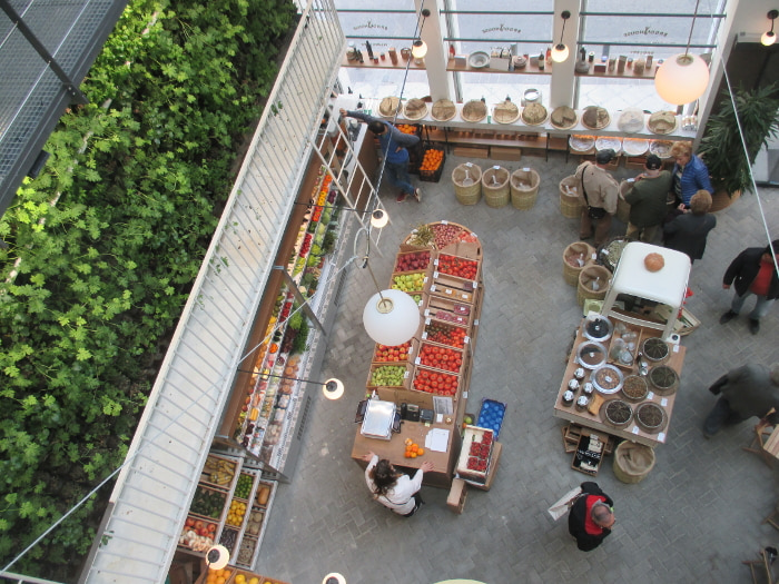 Ergon House Agora (marketplace) from above, showing part of its vertical herb garden and produce section