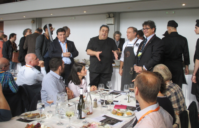 Chefs Christoforos Peskias and Yannis Baxevanis talking to Symposium participants