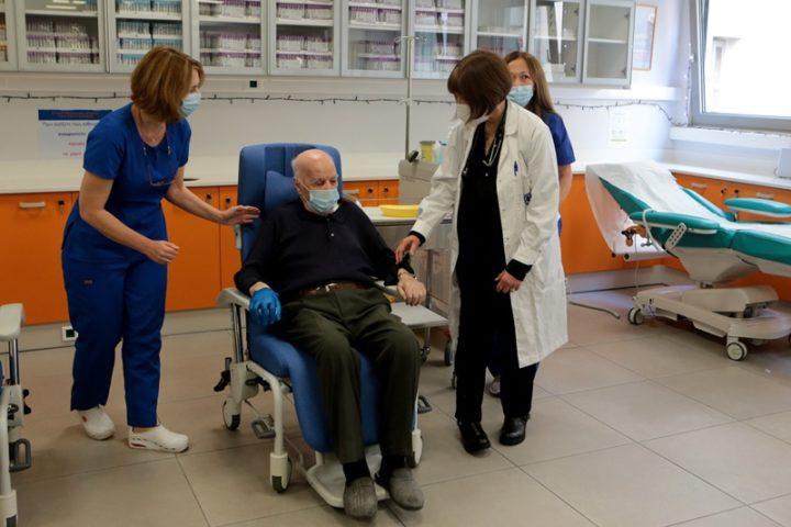 Michael Giovanidis getting his first dose of the Coronavirus vaccine. Credit: AMNA/Pantelis Saitas