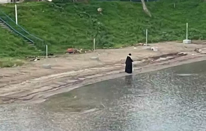 Epiphany Greek priest alone