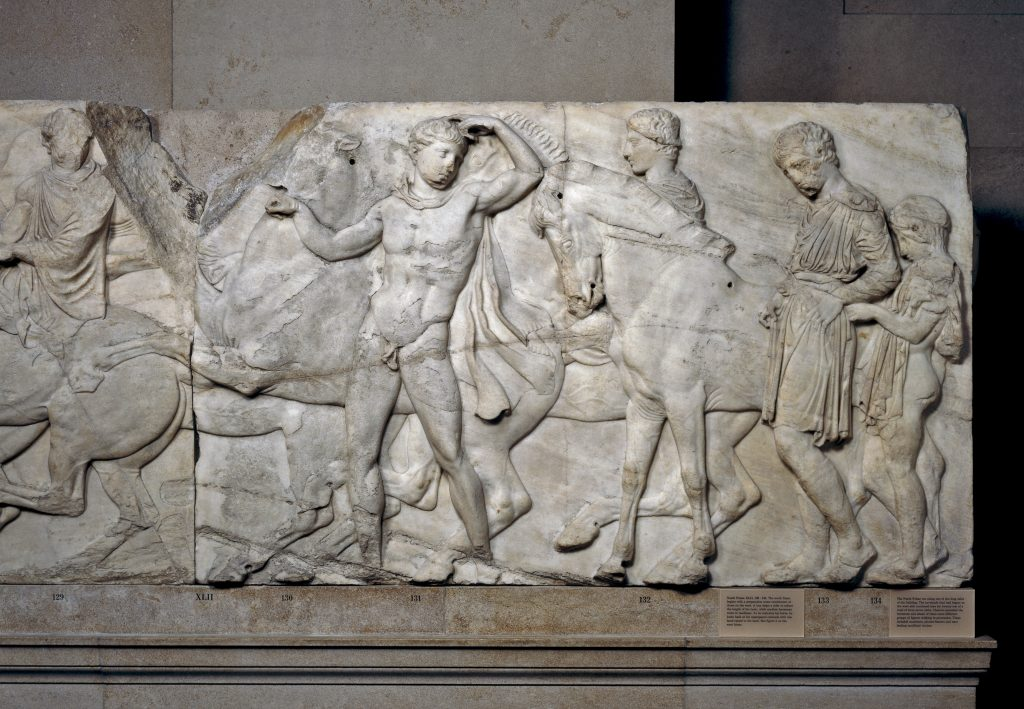 Marble relief (Block XLVII) from the North frieze of the Parthenon.  The frieze shows the procession of the Panathenaic festival, the commemoration of the birthday of the goddess Athena.  Designed by Phidias, Athens, Greece, 438BC-432BC.  Height 101cm x width 164cm.  © The Trustees of the British Museum.