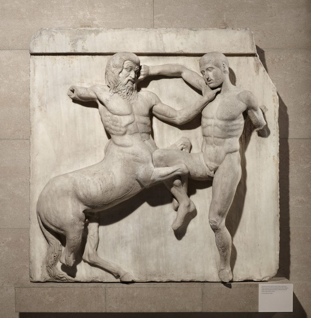 Marble metope from the Parthenon (South metope XXXI).  This metope is from the eastern half of the south side of the temple.  The South metopes in the British Museum show the battle between Centaurs and Lapiths at the marriage-feast of Peirithoos.  Designed by Phidias, Athens, Greece, 438BC-432BC.  Width 132cm.  © The Trustees of the British Museum.