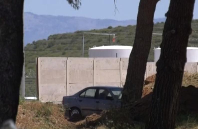 Greece refugees concrete walls