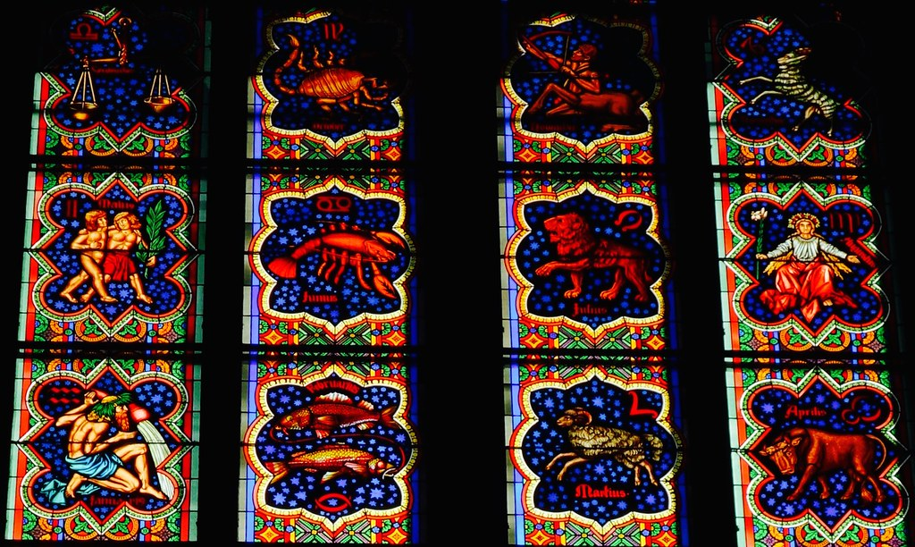 Astrological signs in a window in Köln Cathedral in Cologne, North Rhine-Westphalia, Germany.
