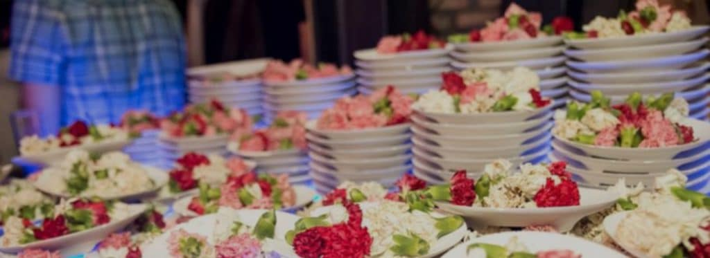 smashed plates and flowers at nightclubs