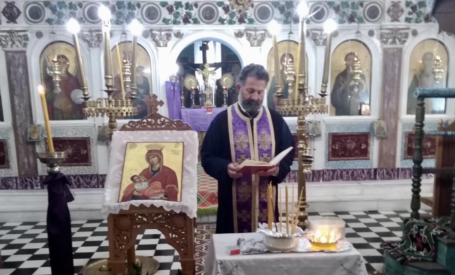 Priest in Kokkinomilia Church of Agioi Taxiarchai Evia