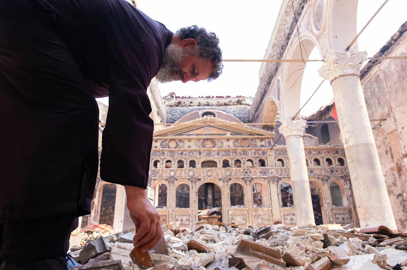Priest in destoyed church of Kokkinomilia Evia Fire Greece